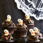 Easy Chocolate Halloween Cupcakes and Icing with a spider web in the background