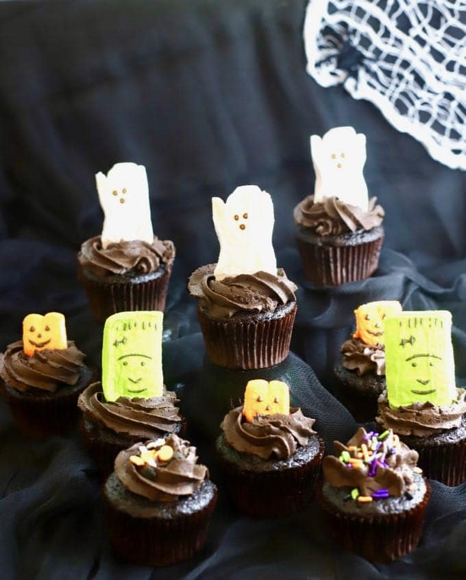 Halloween peeps adorning Easy Chocolate Halloween Cupcakes and Icing