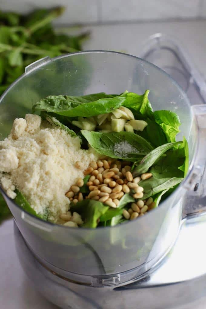 Easy Homemade Southern Basil Pesto ingredients in a food processor