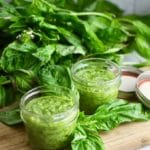 Easy Homemade Southern Basil Pesto in two glass jars