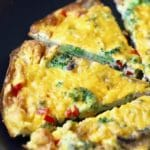 Easy Mushroom Broccoli Frittata cut into slices and ready to serve