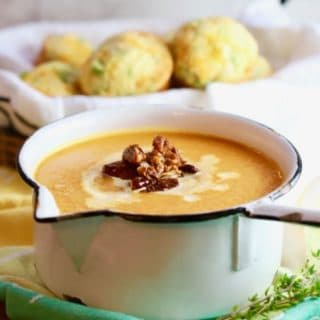 Easy Creamy Southern Sweet Potato Soup in a white pan with muffins in background