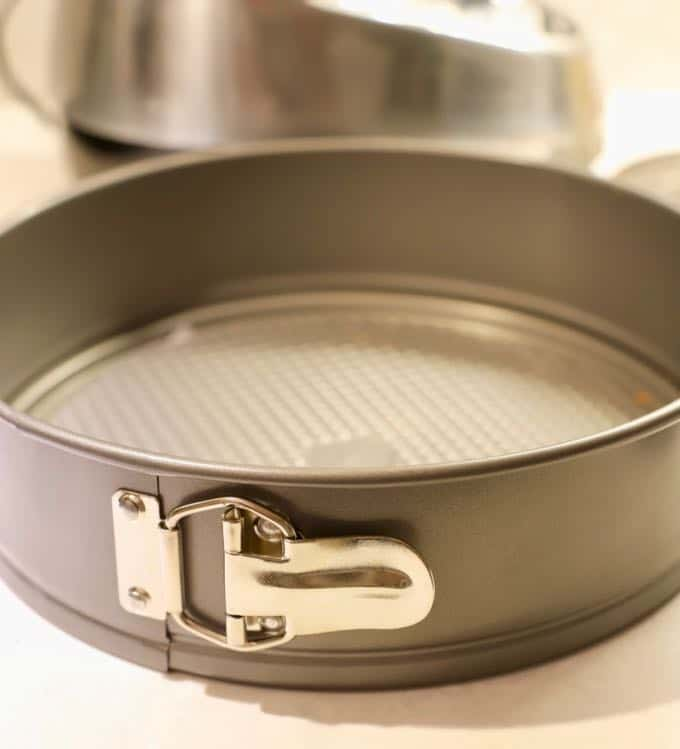 A springform pan used to make Apple Pie Cheesecake with Caramel Sauce