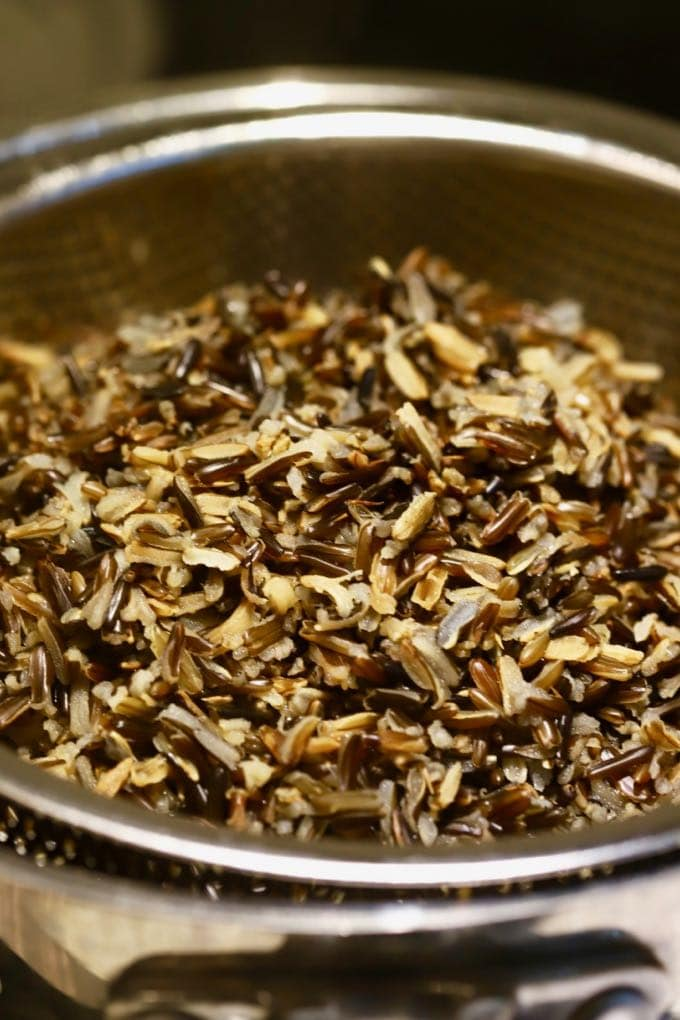 Wild rice in a colander for Creamy Leftover Turkey and Wild Rice Soup