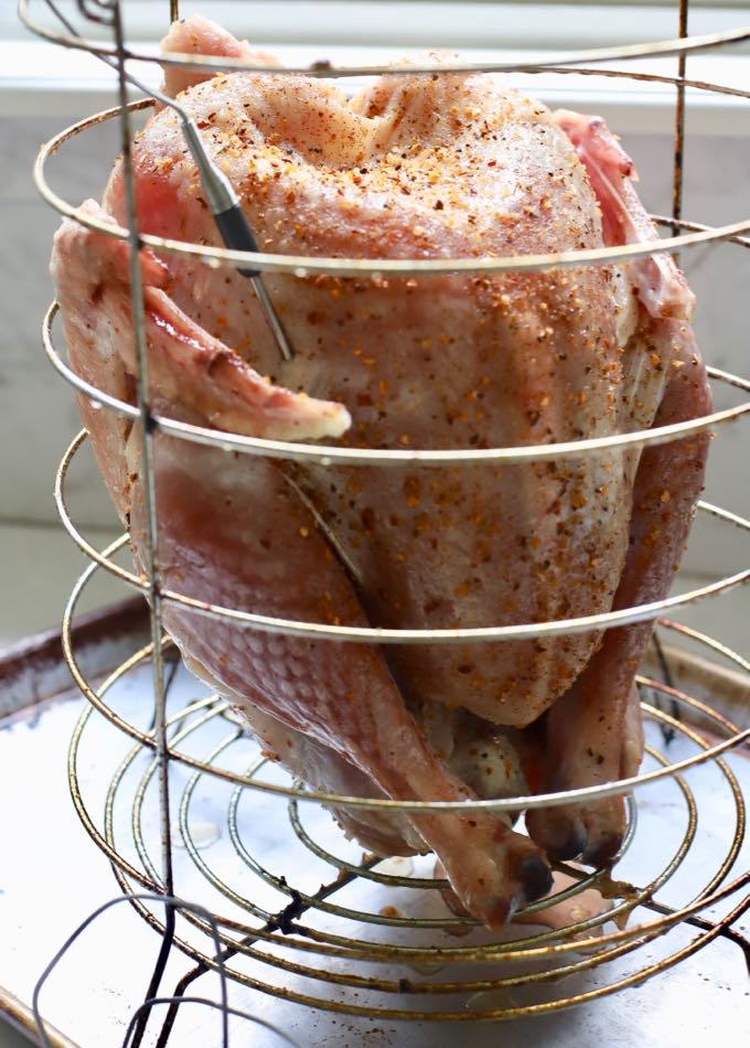 Dry Brined Fried Turkey without Oil in a cooking basked with a temperature probe