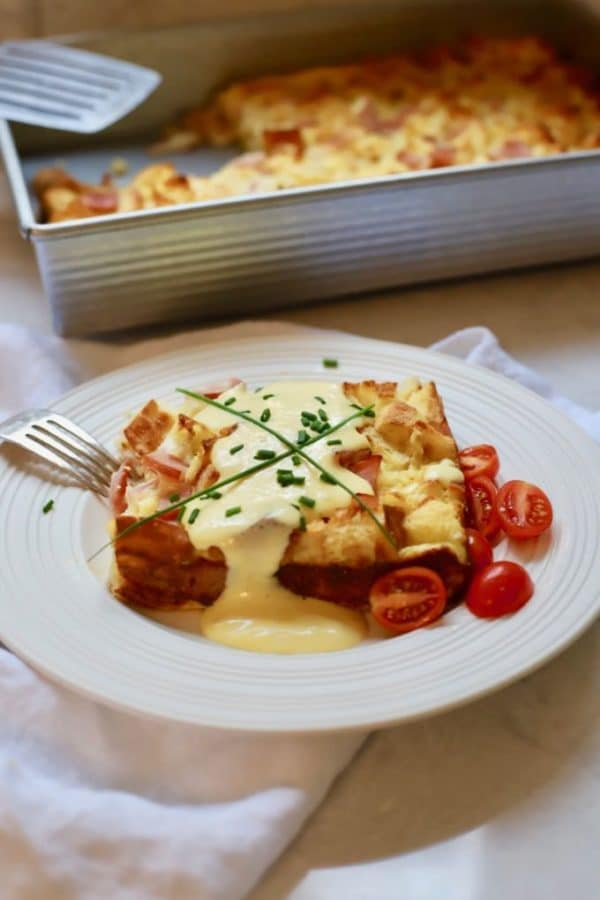 Easy Eggs Benedict Casserole on a white plate with Blender Hollandaise Sauce