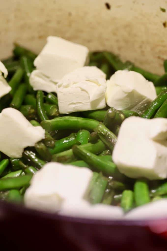 Adding cream cheese to green beans forGreen Bean Pie with Ritz Cracker Crust