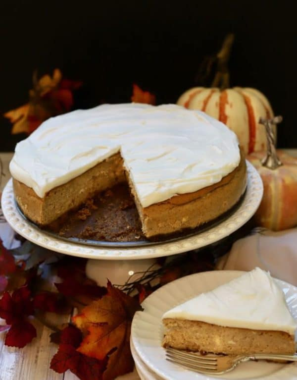 Cutting a slice out of a Pumpkin Cheesecake with Gingersnap Crust