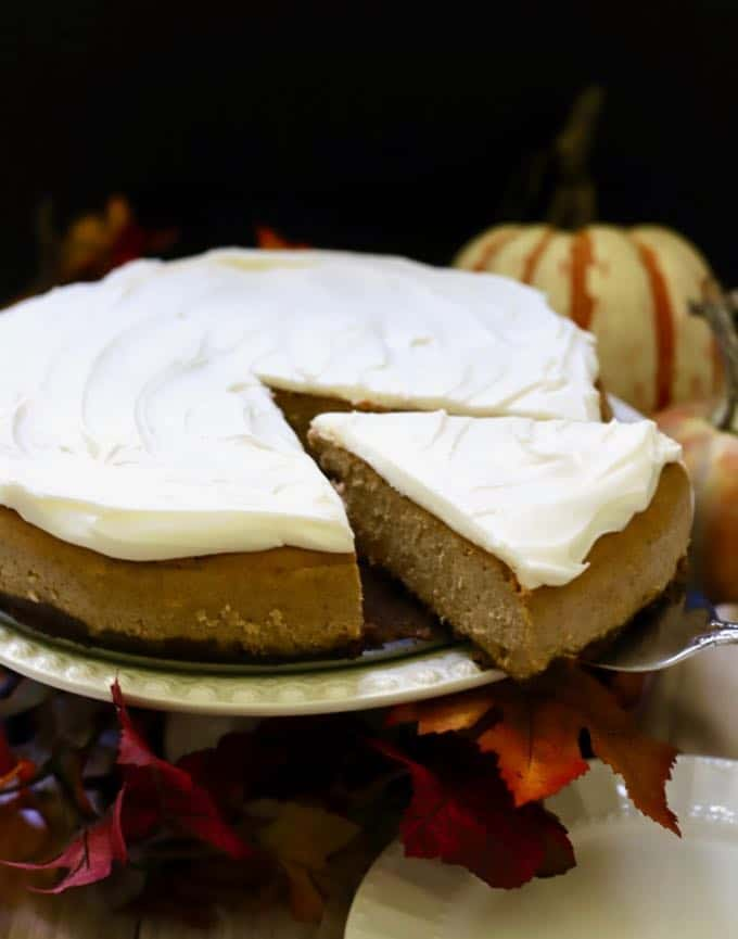 Cutting a slice of Pumpkin Cheesecake with Gingersnap Crust