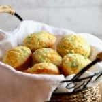 Broccoli Cheddar Cornbread Muffins in a basket.