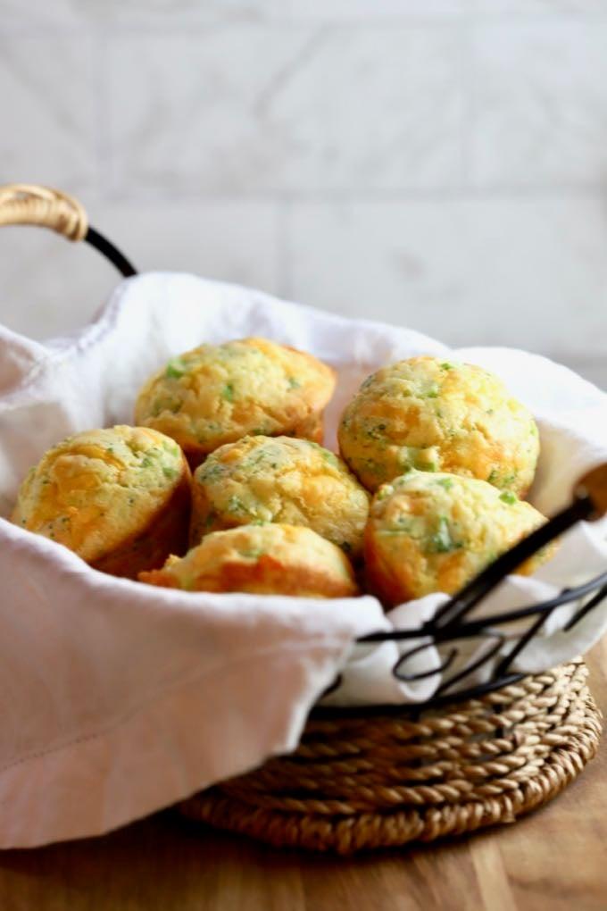 Broccoli Cheddar Cornbread Mini Muffins in a small basket.