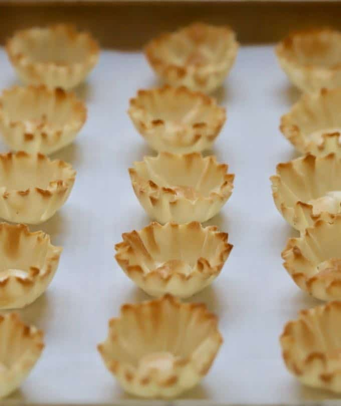 Frozen filllo shells on a baking sheet for Cranberry Brie Bites