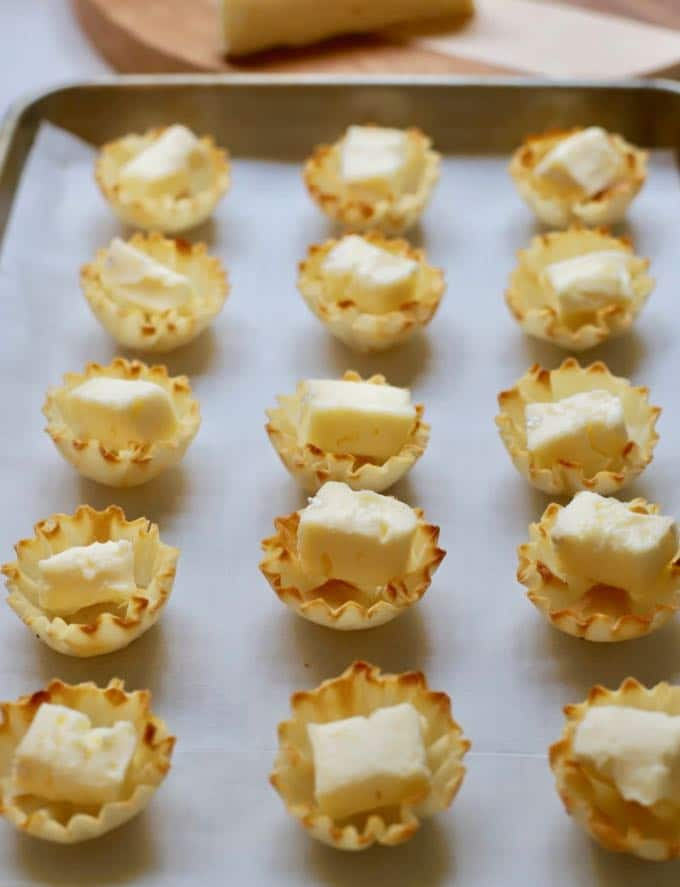 Cubes of brie in fillo shells to make Cranberry Brie Bites
