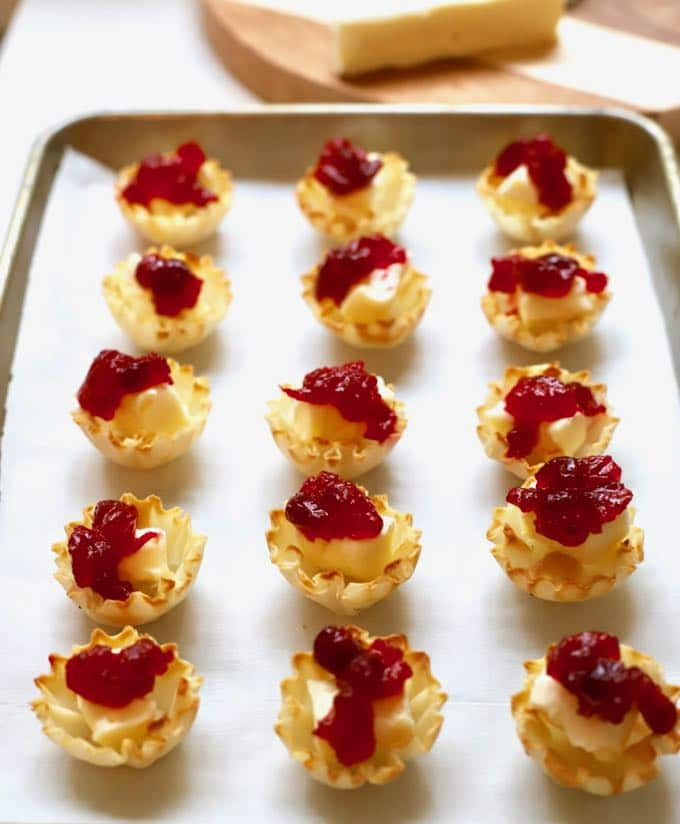 Cranberry Brie Bites on a baking sheet ready for the oven.