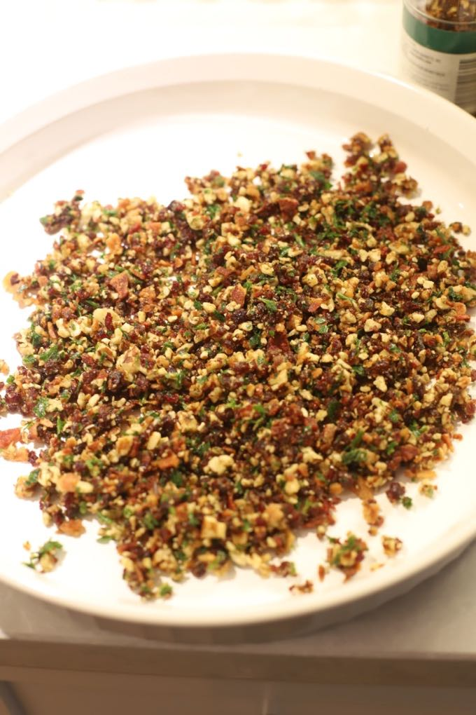 Finely chopped cranberry pecan mixture in a bowl to make Cranberry Pecan Mini Goat Cheese Balls.