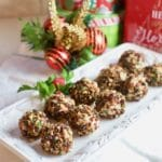 Cranberry Pecan Mini Goat Cheese Balls on a white plate.