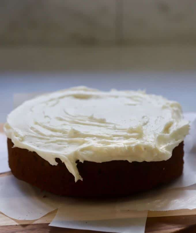 Icing the first layer of Gingerbread Cake with Cream Cheese Icing