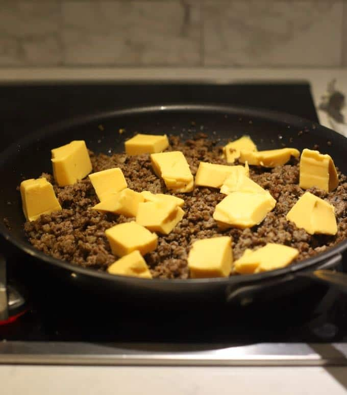 Adding cheese to the meat mixture for Quick and Easy Hanky Pankies.