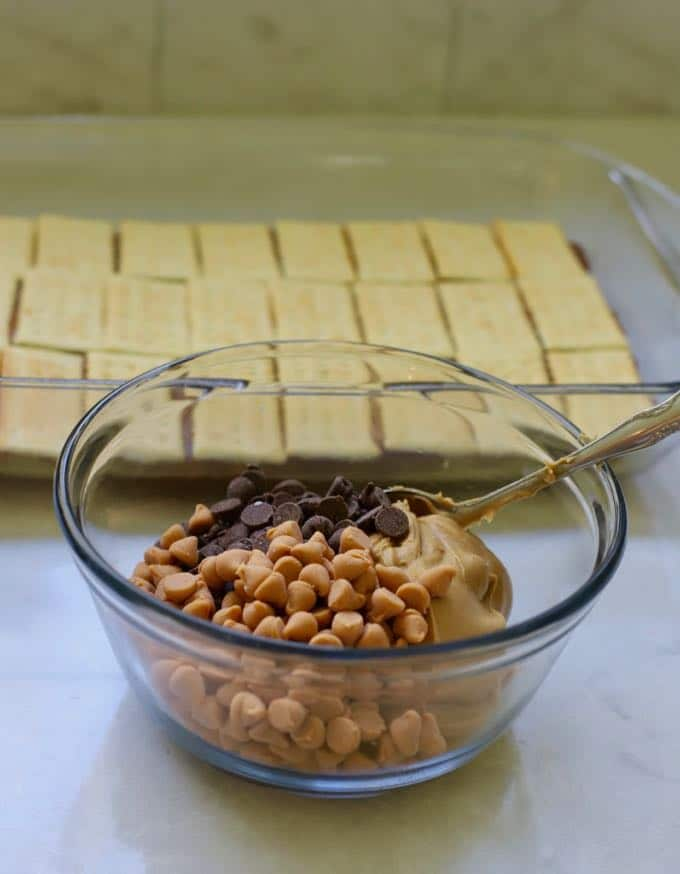Chocolate and butterscotch chips and peanut butter in a bowl to make homemade copycat kit kat bars.