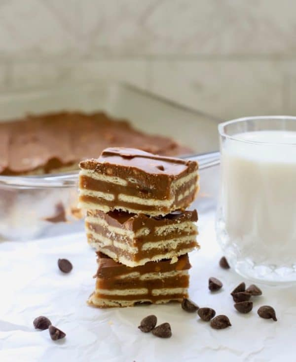A stack of three homemade copycat kit kat bars and a glass of milk