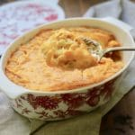 A large spoonful of Southern Cheesy Corn Pudding
