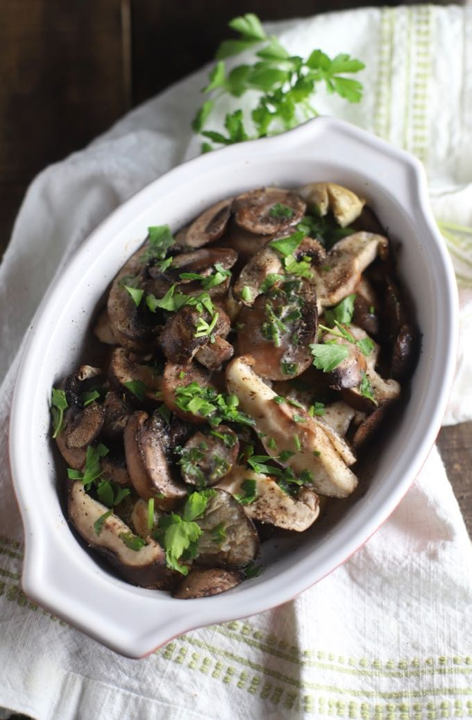 Baked Mushroom Casserole garnished with parsley in a white baking dish.