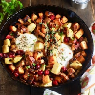 Easy Southern Sweet Potato Hash with eggs in a cast iron skillet.