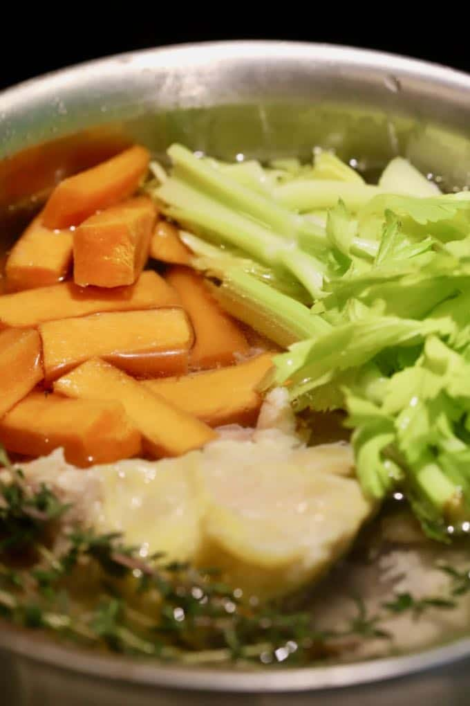 Vegetables in a sauce pan to make homemade chicken stock.