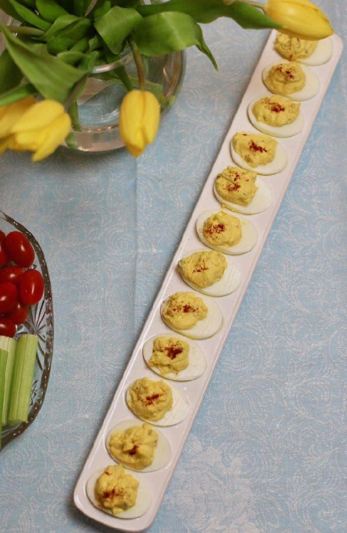 Classic Southern Deviled Eggs on a long narrow deviled egg serving dish.