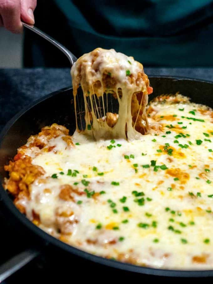 Chicken and rice casserole in a black cast iron pan.