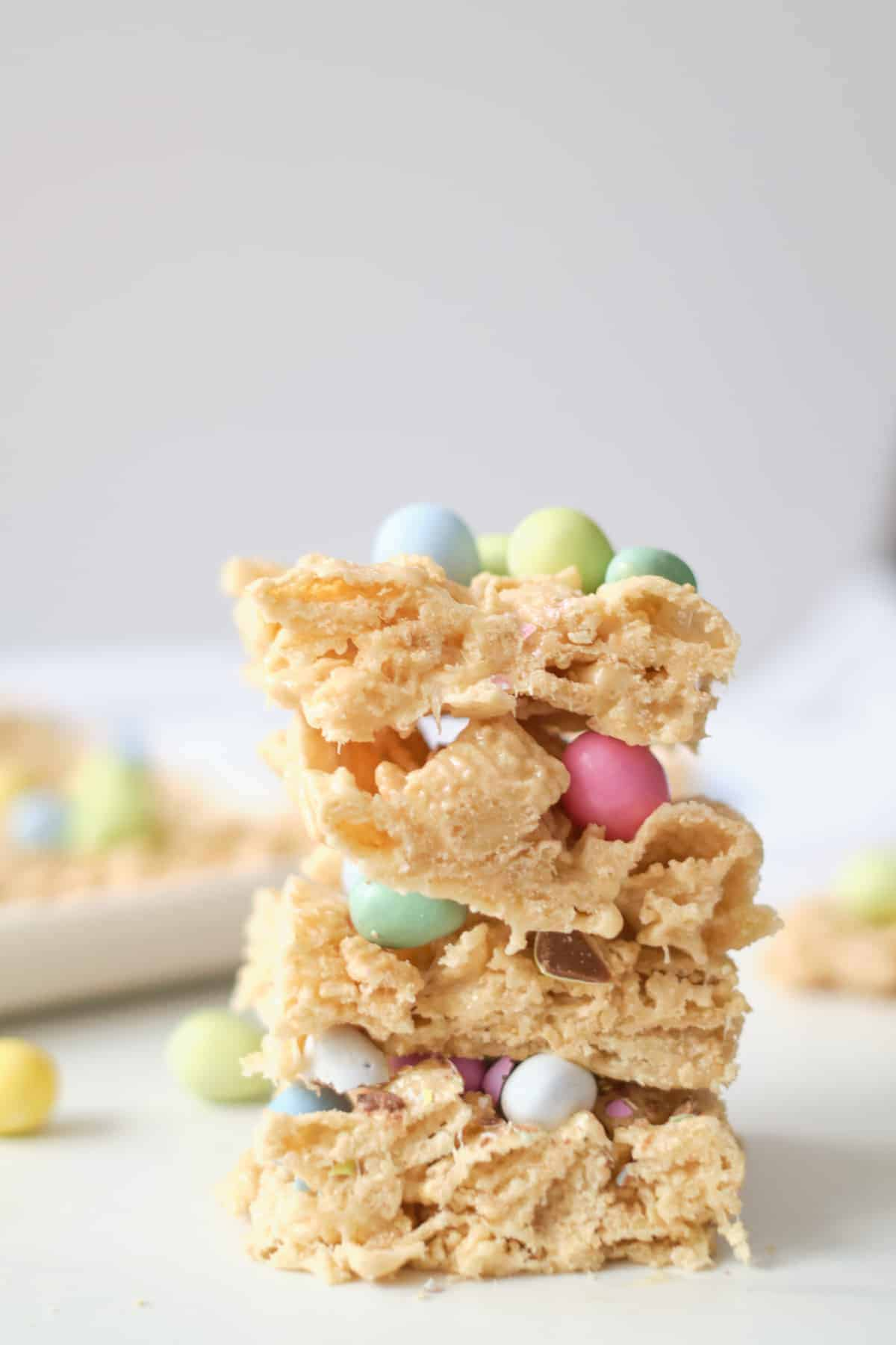 Three Easter cookie bars made with Chex cereal topped with candy.