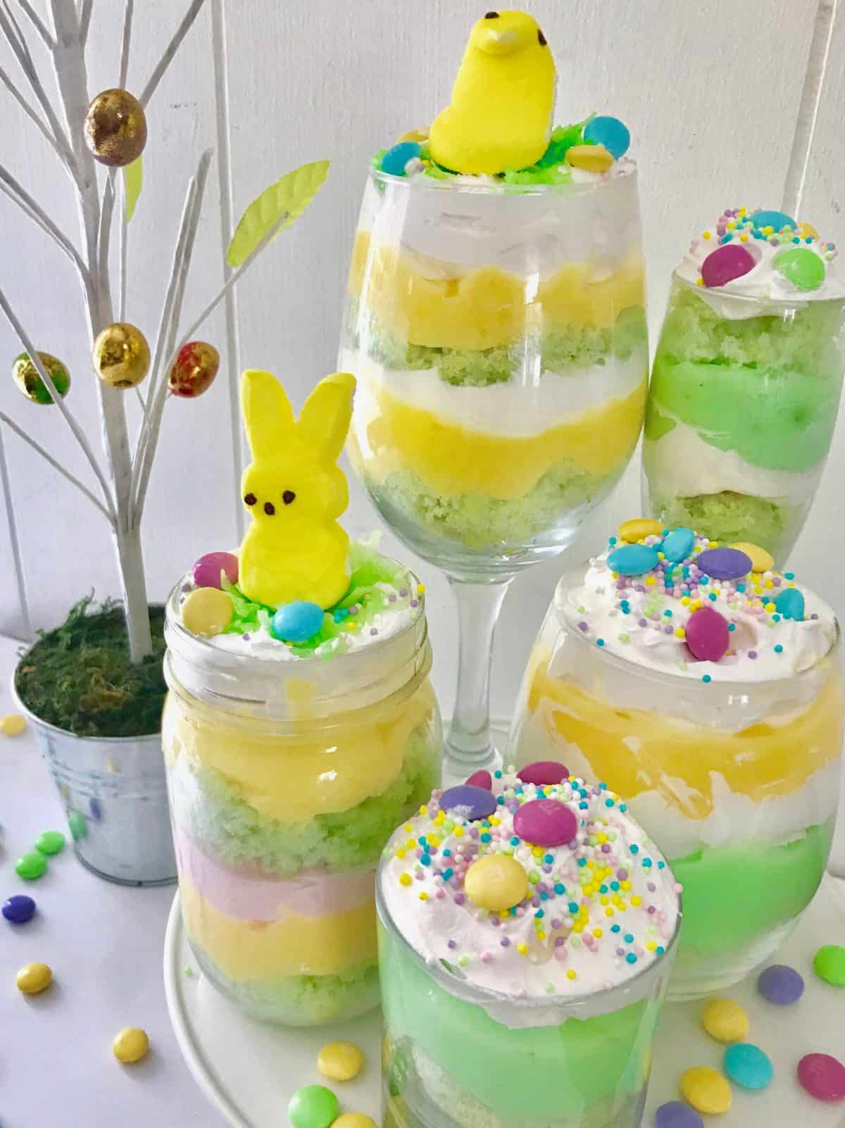Five multicolor trifles topped with candy. aster
