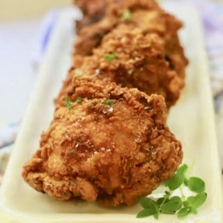 Southern fried chicken on a white serving plate