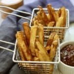 Two wire baskets with homemade french fries.