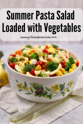 Pinterest pin with an image of a large serving bowl full of pasta salad with assorted vegetables.