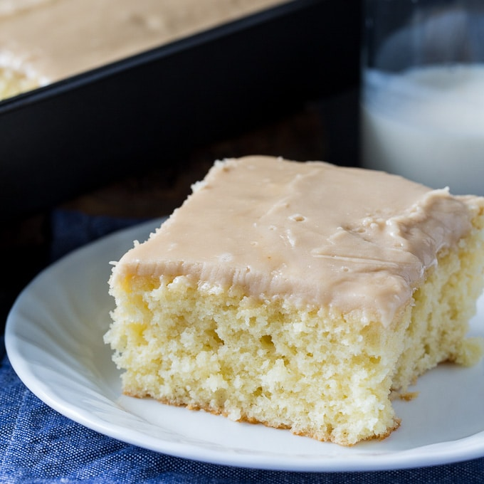 A piece of Buttermilk Sheet Cake with Caramel Icing on a plate.