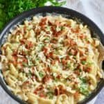 Chicken and bacon pasta in a skillet ready to eat.