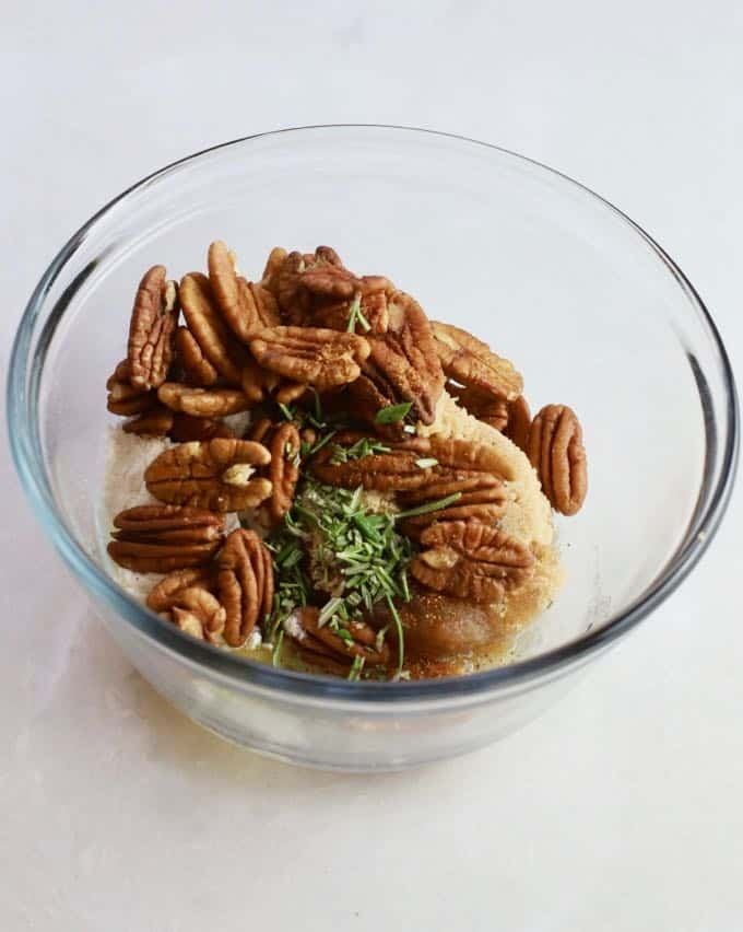 Pecans, brown sugar, butter, and flour in a clear glass bowl to make the pecan topping for sweet potato casserole.