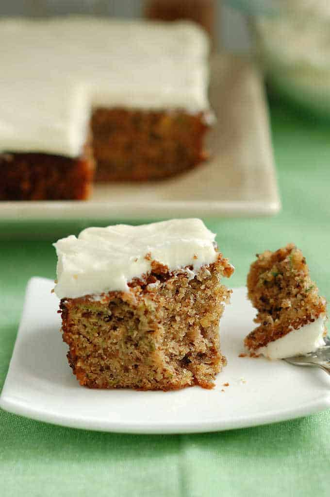 A slice of Zucchini Cake with Cream Cheese Icing.
