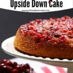 Pinterest pin for cranberry upside down cake showing cake on a white platter with cranberries below.
