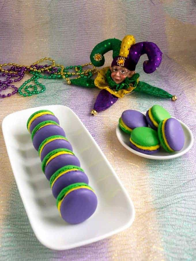 Green and Purple Mardi Gras Macaroons on a plate.