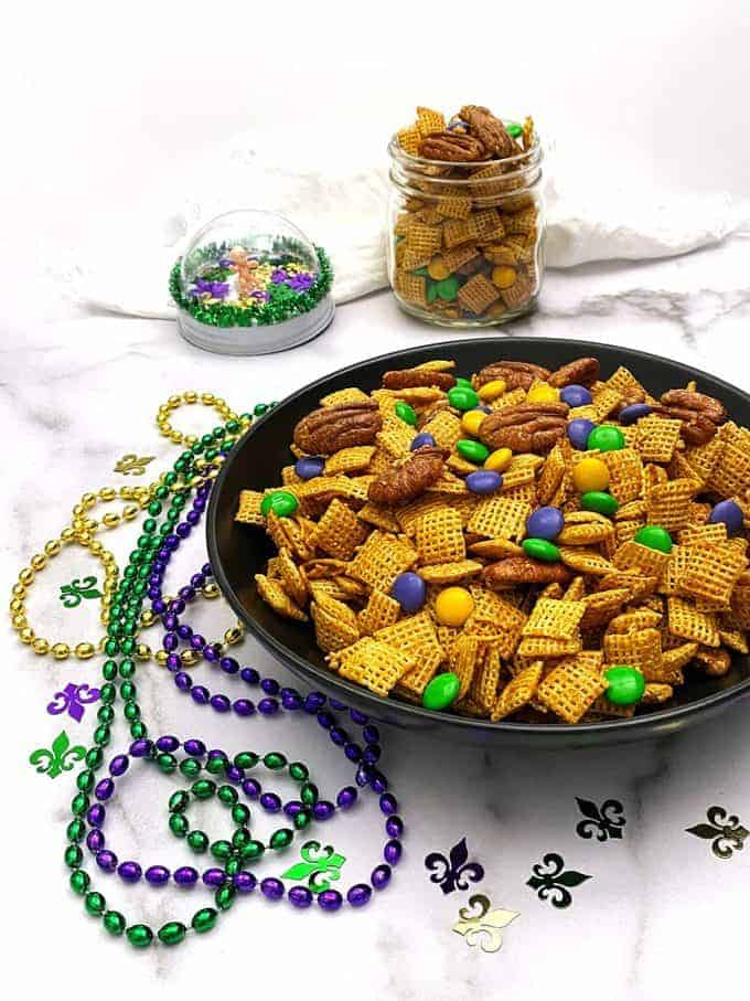 Mardi Gras Praline Crunch in a bowl with mardi gras beads.