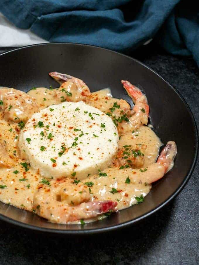 Boursin grits with shrimp cooked in a cream sauce.