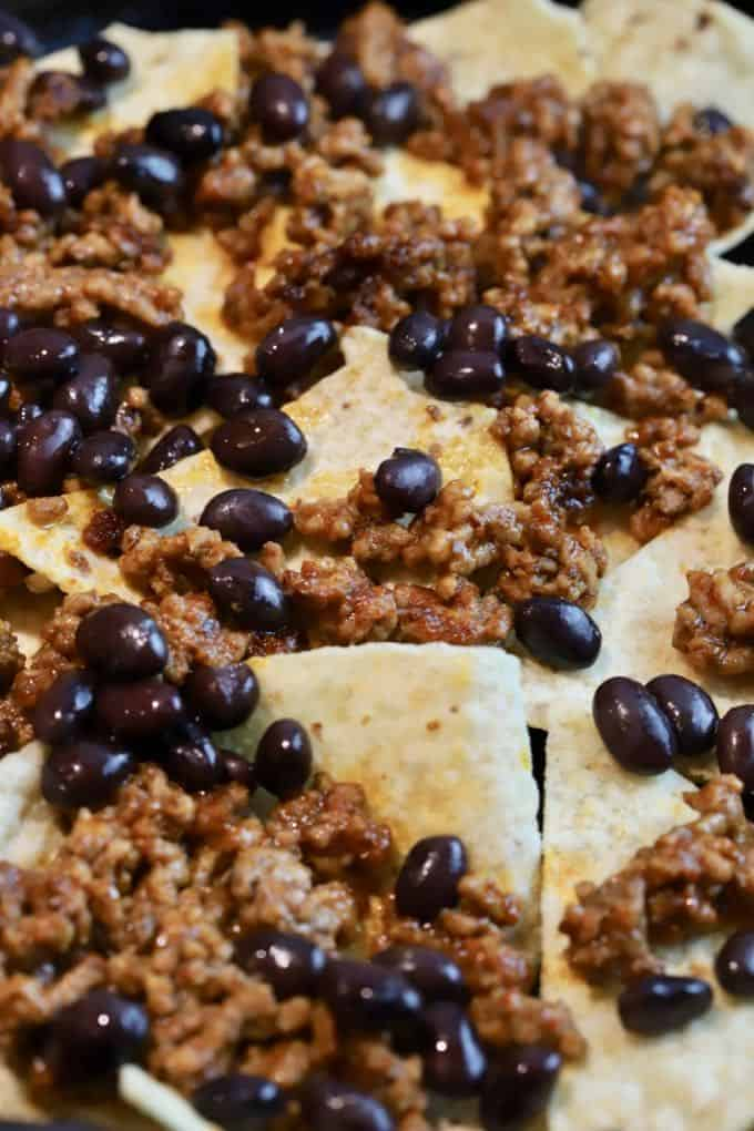 Tortilla chips with taco beef and black beans.