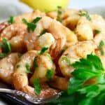 Smoked shrimp on a plate garnished with parsley.