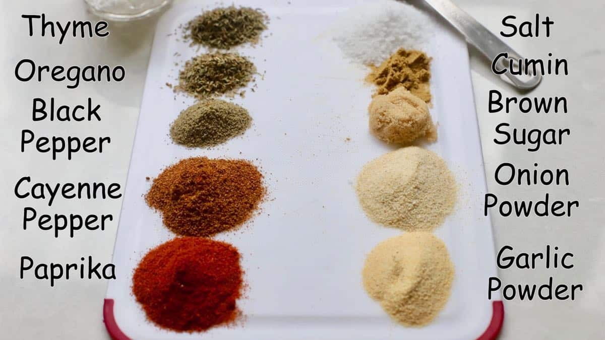 Spices and herbs to make blackening spice mix on a cutting board.