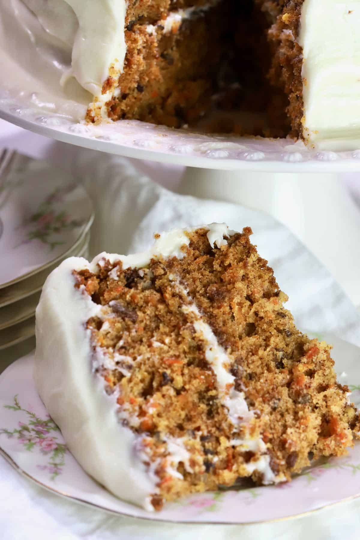 A slice of carrot cake with cream cheese icing.