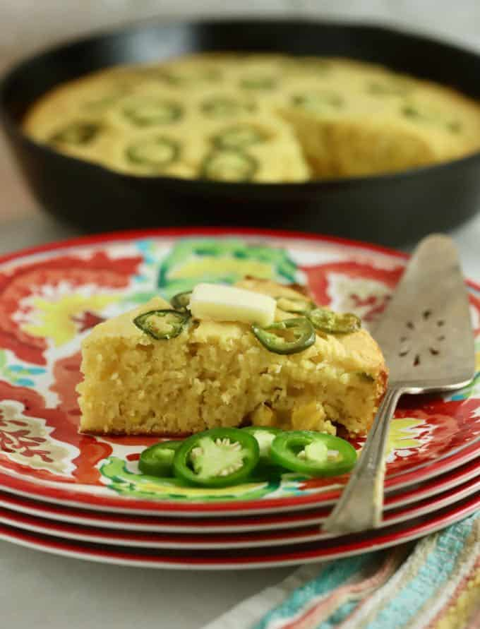 A slice of cornbread topped with jalapeno slices.