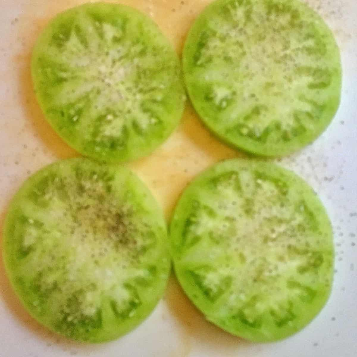 Four slices of green tomatoes.