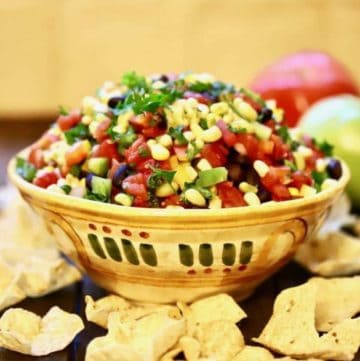 Redneck caviar in a pottery bowl surrounded with chips.